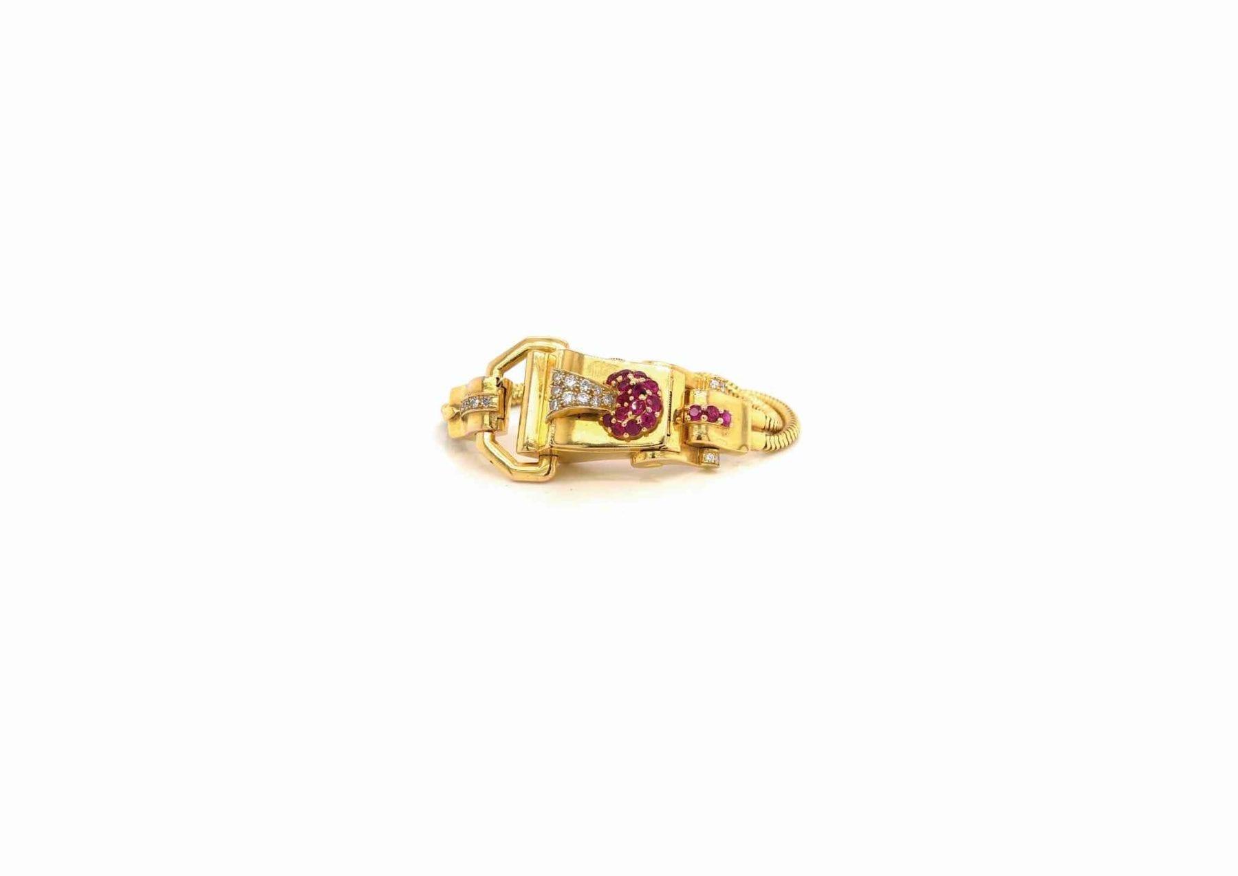 Montre d'occasion or rubis et diamants