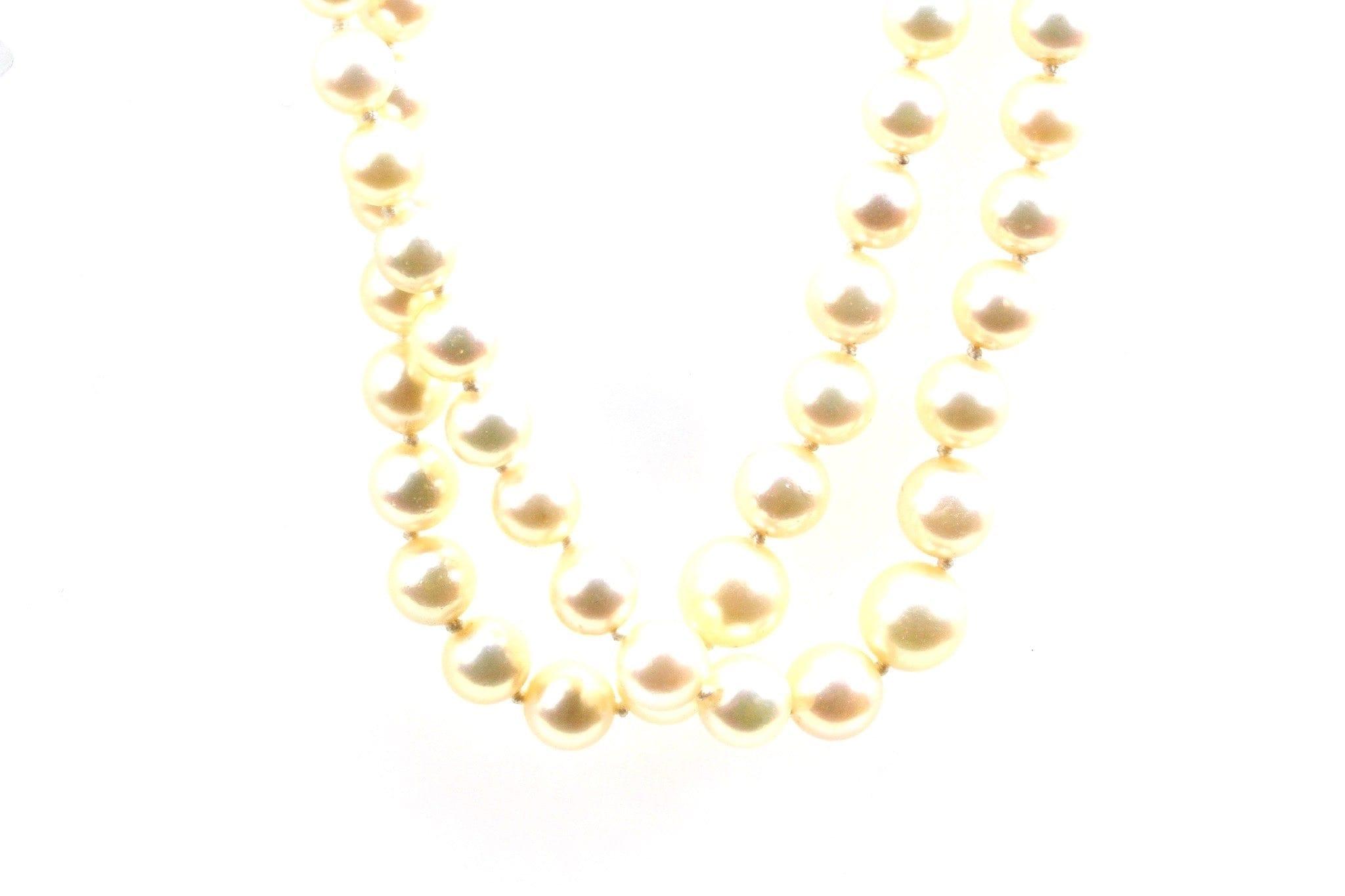Collier de perles deux rangs et fermoir en or jaune 18k